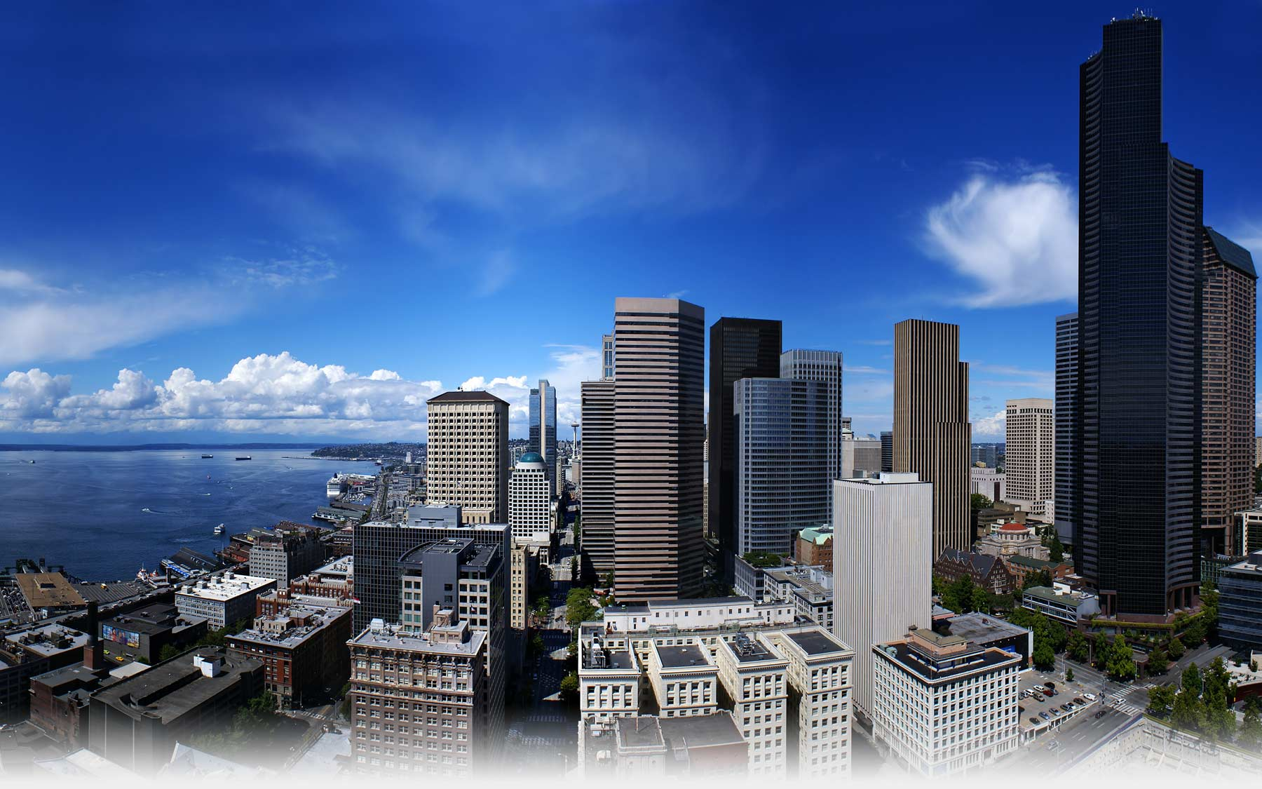 One-point perspective photograph of downtown Seattle, WA on a mostly sunny day